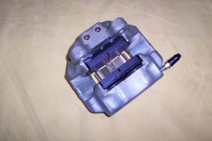 365 / 512 Left Rear Caliper with pads and hardware (core charge included in price)-108077