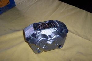 512 Brake Caliper Front Left (core charge included in price)-124664